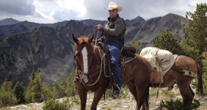 Retired Army Reserve Col. Tom Brewer takes part in a camping and horseback excursion near Bozeman, Montana, in July as part of the Heroes and Horses program, which seeks to help wounded veterans heal through a weeklong ranching and camping experience.